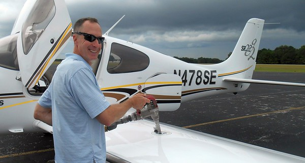 Pilot Will and his beautiful SR-22 plane.