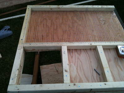 Use a drill to create a holes in the entrance, and use a sawsall to remove the plywood floor.