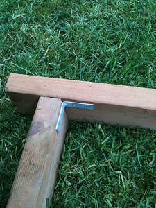 Flip the frame over so the flat joints you just attached are now on the ground, and join the pieces together again, this time on the inside using a different form of 90-degree joint. You could also simply screw the pieces together if you wish.
