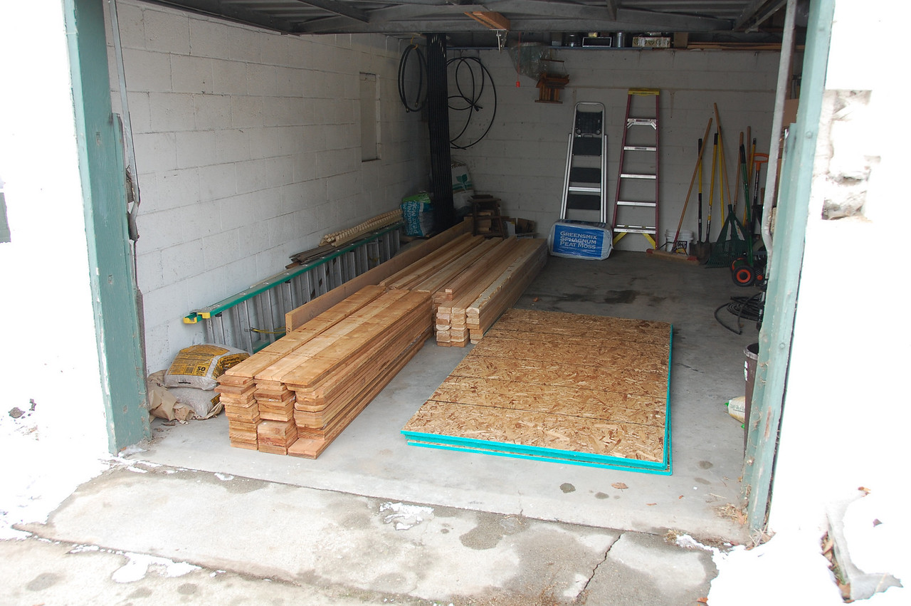 Raw materials for a coop and fence, mostly cedar.