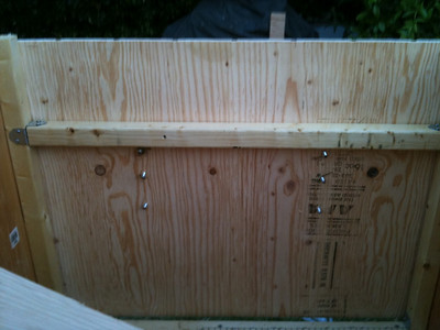 "As you can see, the large hinge screws really stick out and can be a hazard for the chickens, not to mention yourself. Put a short length (6"" or so) of 2x2 to receive the screws along the inside."