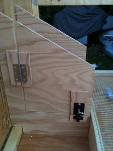 General view of the nesting box with the hinge and bolt installed.