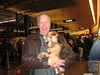 Maude as puppy being smuggled through the airport in my jacket - photo by Cheri Yates