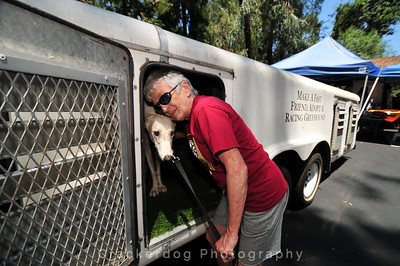 Joyce shares a brief moment with one of the retired greyhounds, Nike.