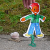 Flat Stanley meets a very large snail. Green army guy is protecting poor Stanley