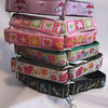 Girly style 1 greyhound tag collars,from the top. Diva, Daisies Hearts Stars pink and green, Daisies Hearts Stars pink and orange, Suzani Gold, Suzani Natural and dragonflies.