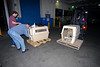 Jake and Bob get ready to open the first crate while the forklift brings over the second greyhound