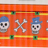 Skulls Wearing Hats on orange
