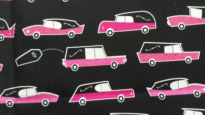 Hearse Pink (one row of cars would be the width of a collar)
