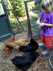 Thalia loves feeding the girls mealworms.