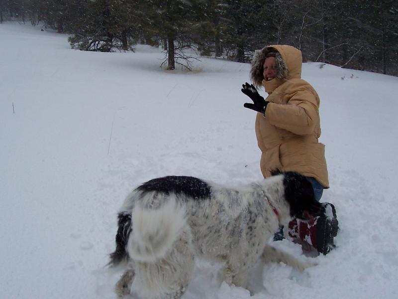 Caroline and Jester play in the snow at Pajarito ski area near Los Alamos.