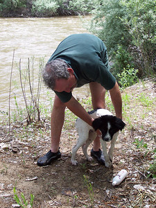 After a dip in the river, Chris soaps up Jester on the river bank.