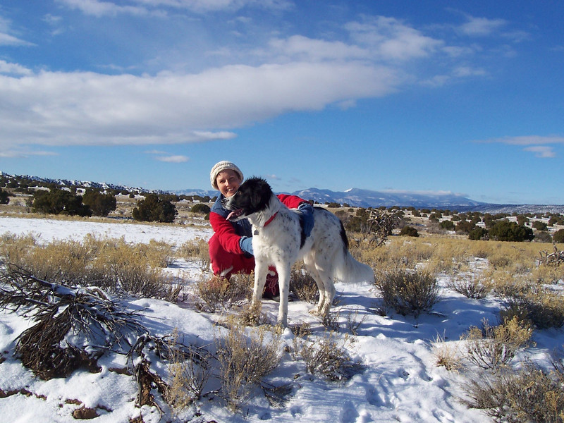 Caroline and Jester pose with the Jemez Mountains in the background.