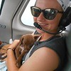 The co-pilot usually gets the smallest pups. They always feel safe and fall asleep in the loving arms of the flight crew.