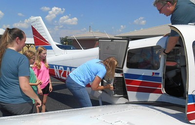 Unloading Pilot Jeff's plane at KEDN.