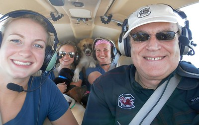 """Melanie, Libby (Newbie), Victoria and Mike .... with  pup """"Beeland"""" tying to join us in flight!"""