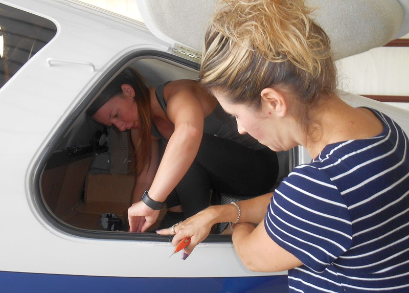 Danielle and Gina getting the plane ready.