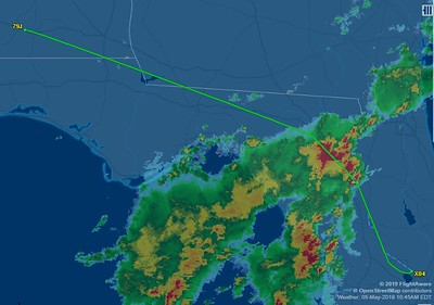 We actually DID NOT fly thru that big, red storm! The weather image is shown when were we in Alabama. There was a gap that we flew thru in that spot. You can see it to the northeast. It was on our route of flight when we got there.
