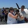 Pilot Jesse, Lynda and Pilot Ron loading the pups.