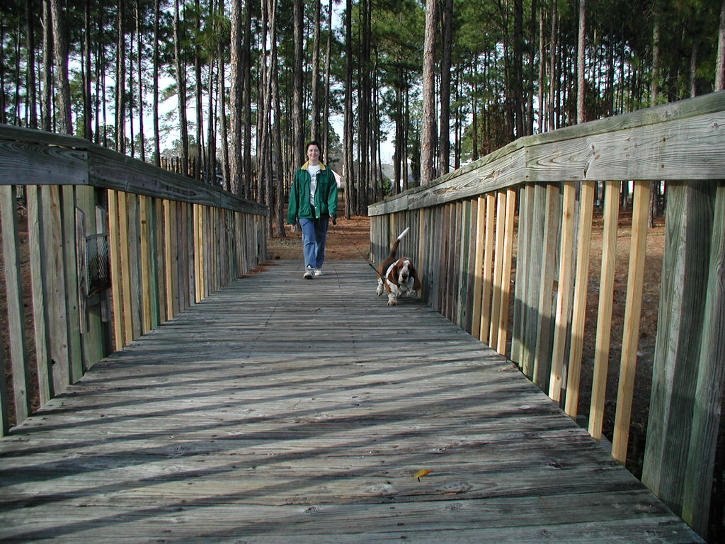 Susan and Minute on a walk in the Highland Lakes park.