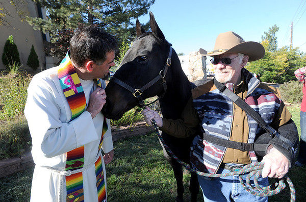 "Rev. Martin Lettow, left, has some kind works for Ebony the horse before the animal blessing. Ebony is owned by Dick Werpy, right.<br /> The Shepherd of the Hills Lutheran Church in Boulder, held a Blessing of the Animals service on October 7, 2012.<br /> For more photos and a video of the blessing, go to  <a href=""http://www.dailycamera.com"">http://www.dailycamera.com</a>.<br /> Cliff Grassmick  / October 7, 2012"