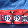 "Peace on red, shown in 1 1/2"" wide martingale collar"