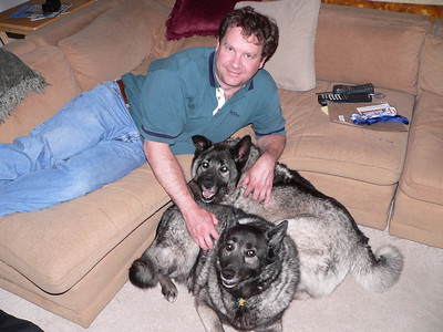 Dave with puppy pile, July 2005