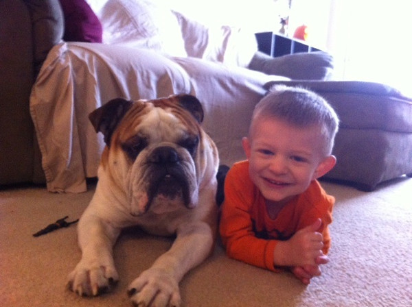 My grandson Hunter getting cozy with his four-legged brother Chubs.<br /> <br /> Photographer's Name: Dana Clapper<br /> Photographer's City and State: Anderson, Ind.