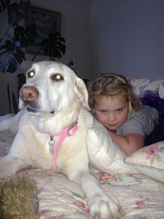 Our granddaughter Gabby Hylton with our lab, Zoey.<br /> <br /> Photographer's Name: Cundi Roberson<br /> Photographer's City and State: Anderson, Ind.