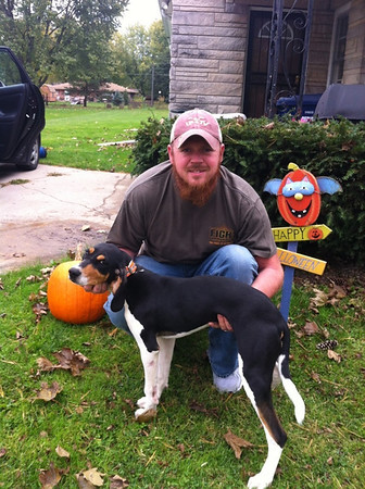 "Justin Roberson ""doing it Walker style""  with his new hunting pup Breeze!<br /> <br /> Photographer's Name: Cyndi Roberson<br /> Photographer's City and State: Anderson, IN"