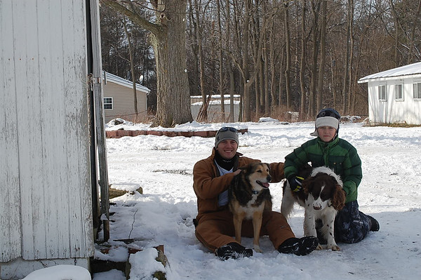My nephews Colton Wesollek and Hayden Martin with their dogs Zoe and Zip relaxing in the snow.<br /> <br /> Photographer's Name: Mary King<br /> Photographer's City and State: Elwood, IN