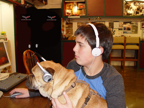 My grandson Eric Schmidt and my dog Gabby watching YouTube videos.<br /> <br /> Photographer's Name: Eric Schmidt<br /> Photographer's City and State: Alexandria, Ind.