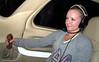 Amamda at the controls flying back at night