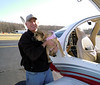 Greg Marshall helps with the dogs on the rescue flight at Potomac Airfield.
