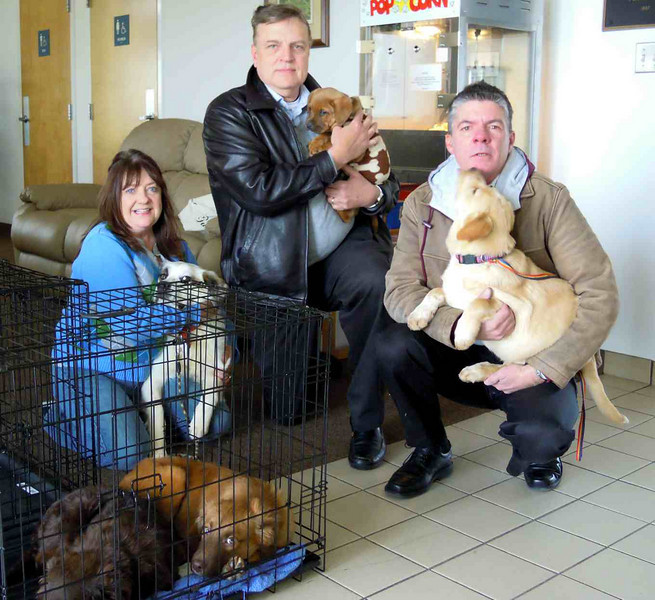 Rhonda, Mike and Mark with the five dogs at Roxboro, NC before the trip to Blue Bell, PA for adoption.