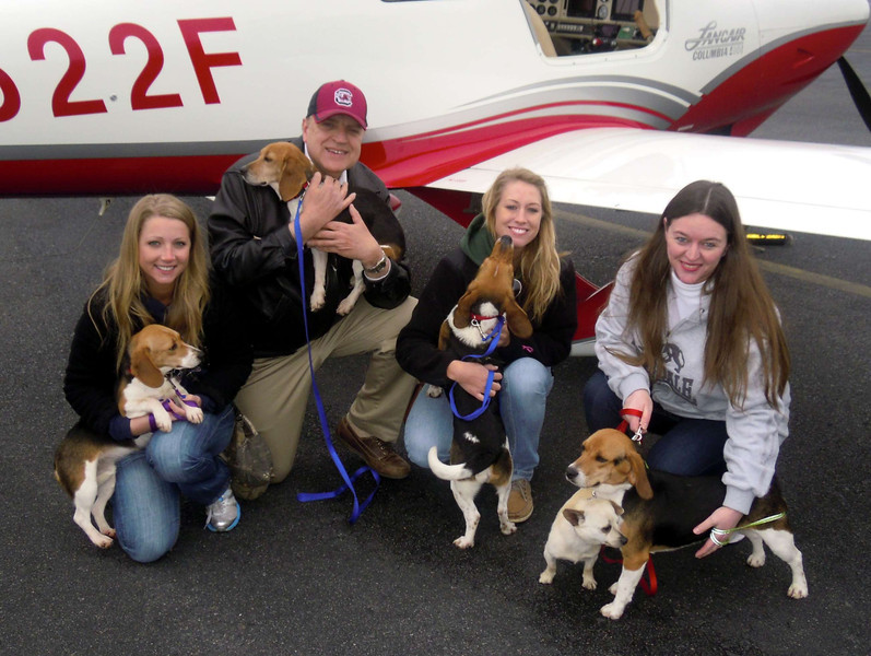 The Gang at Monroe, NC airport (KEQY) before we departed. From left to right: Erica, Mike, Melissa and Jacq, who pulled the dogs from the shelter the shelter the day they were to be gassed. She is the angel in this picture. :)