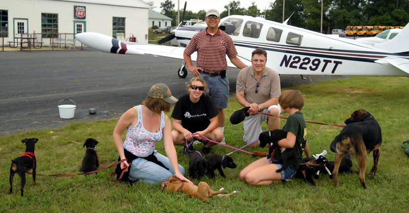 Rick (with hat on)  brought 8 dogs up from NC in his beautiful, new Bonanza. We took them onto Blue Bell, PA (Wings Field) in my Columbia 400.