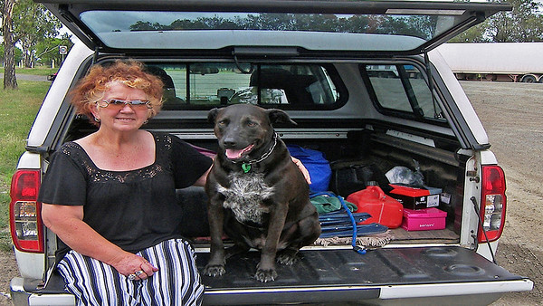Barbara and our mate Spanner waiting for Keith at Rockhampton ro