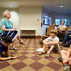 Sally Cragin, of the TheraPAWS therapy pet group, speaks during an open house at Thayer Memorial Library in Lancaster on Wednesday evening to teach interested residents about how their pet can become a therapy pet. SENTINEL & ENTERPRISE / Ashley Green