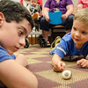Christopher Cragin Warner and Brosnan Malek, 3, hang out with a hermit crab during an open house with TheraPAWS at Thayer Memorial Library in Lancaster on Wednesday evening to teach interested residents about how their pet can become a therapy pet. SENTINEL & ENTERPRISE / Ashley Green
