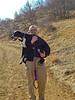Carrying Bozzy down Manor House Trail at Ken Caryl. Feb. 2006.