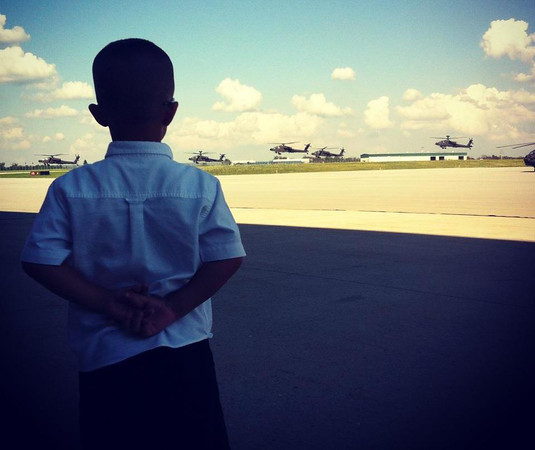 Such a beautiful moment captured of our little boy watching Daddy fly off for a deployment, that is worth sharing! Not sure if there is any strength comparable to that of a military child. I feel grateful every day for the sacrifice of military families to go an entire year without their loved one to protect us and our freedom<br /> <br /> Photographer's Name: Jessie Anderson<br /> Photographer's City and State: Johnstown, PA
