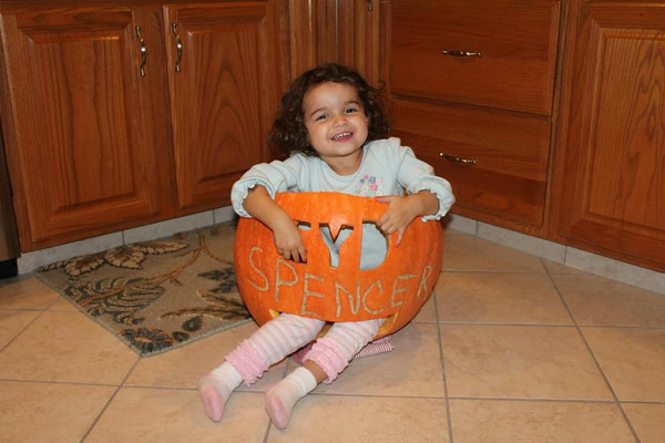 Sydney Stouffer in pumpkin<br /> <br /> Photographer's Name: Carol Stouffer<br /> Photographer's City and State: Johnstown, PA