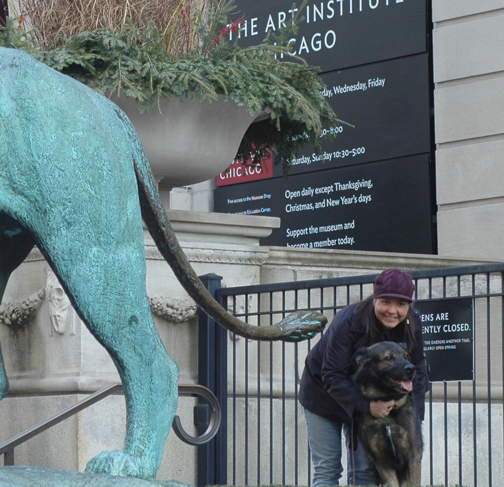 Posing by the AIC lions (before the guard kicked us out)