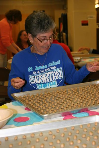 #7   jo ann pedder rolling cookies in st. james stampede shirt