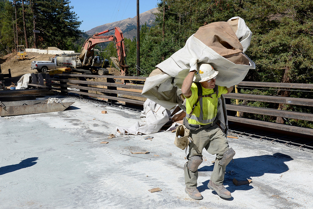 . Work crews are in the final stages of work on the Pfeiffer Canyon Bridge on Highway One on Monday, Oct. 2, 2017.  (Vern Fisher - Monterey Herald)