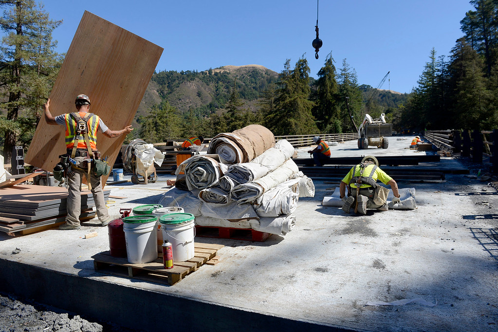 . Work crews prepare the Pfeiffer Canyon Bridge on Highway One for paving the roadway on Monday, Oct. 2, 2017.  (Vern Fisher - Monterey Herald)