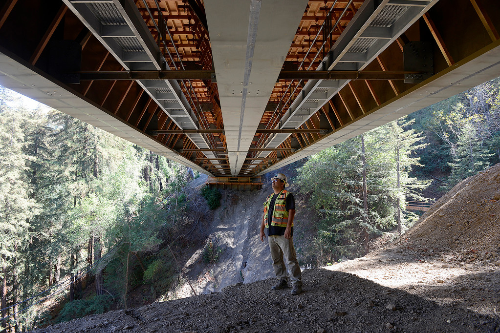 . David Galarza with Cal Trans inspects the underneath of the new Pfeiffer Canyon Bridge on Highway One on Monday, Oct. 2, 2017.  (Vern Fisher - Monterey Herald)