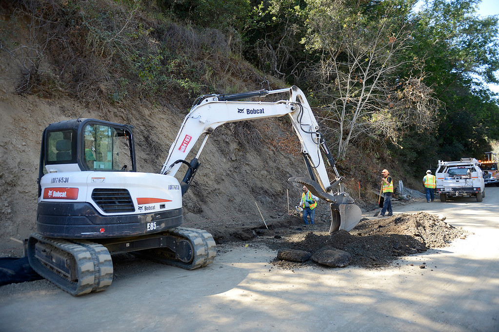 . Work crews improve drainage on the north side of the Pfeiffer Canyon Bridge on Highway One on Monday, Oct. 2, 2017.  (Vern Fisher - Monterey Herald)