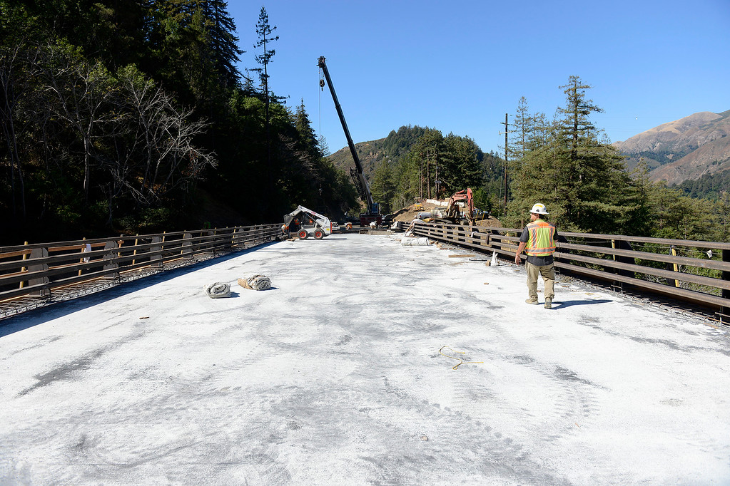 . David Galarza with Cal Trans walks the recently poured cement on the Pfeiffer Canyon Bridge on Highway One on Monday, Oct. 2, 2017.  (Vern Fisher - Monterey Herald)